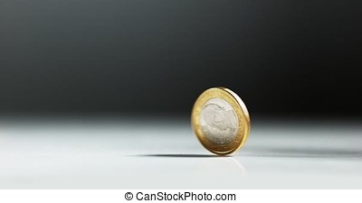 Coin of 1 Euro Rolling against White Background, Slow motion...