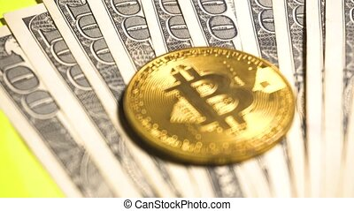 Coin of Bitcoin digital currency and dollars at yellow...