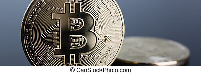 Coin of crypto currency bitcoin on a gray-blue