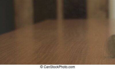 coin on the table rotates slowly