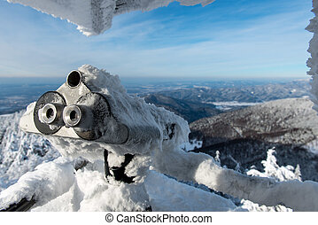 Binocular Covered By Snow In Winter