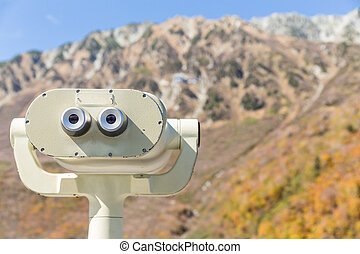 Coin Operated Binocular viewer for tourist with the background of landscape