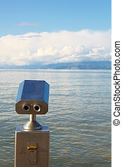 Coin operated viewer - A metallic coin operated viewer for...