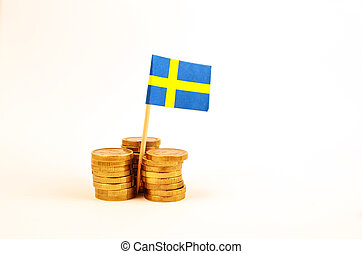 Coin piles and a swedish flag
