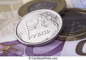 coin ruble against the background of Euro banknotes