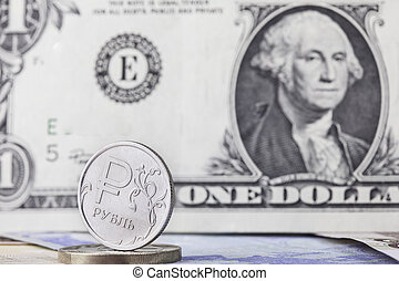 coin ruble on the background bills dollar and Euro