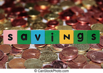 coin savings in toy letters