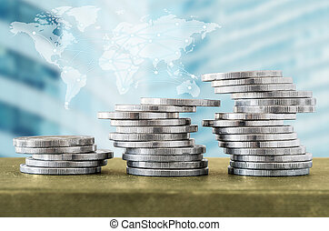 Coin stacks and digital network line with world map, cityscape background.
