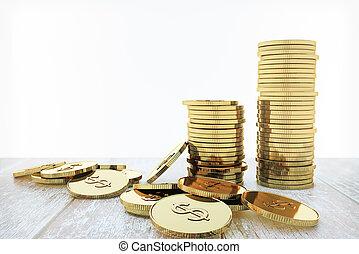 Coin stacks - Stack of golden dollar coins on wooden desktop...