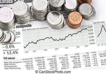 Coin stocks - coins stacked on the stock page of a newspaper