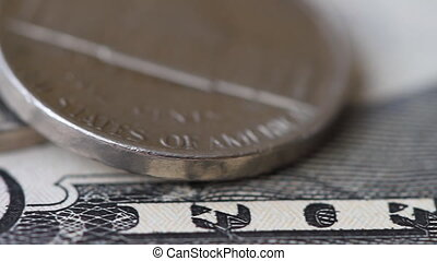 Coins and bills fifty dollars close-up with a slider