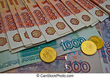 Coins and different banknotes