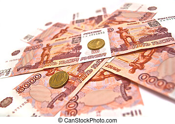 Coins and five thousand rubles banknotes