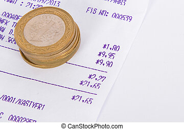 Turkish Lira coins on cash register receipt, isolated on white background.