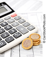 Coins and the calculator on documents.