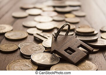 Coins and wooden house key