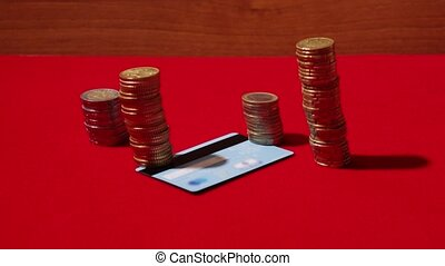 Coins appear in stop motion around the credit card