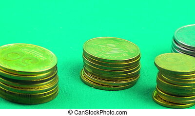 Coins fall one by one by increasing pile up. Animated rising stack of coins. Time Lapse