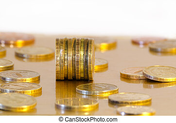 Coins are reflecting in the Golden