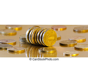 Coins are reflecting in the Golden surface