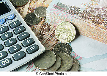 Coins, bank notes and calculator