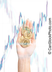 Coins bitcoin on female palm hand with infographic.