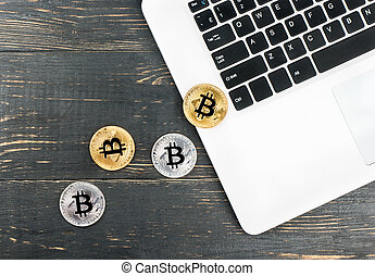 Coins bitcoin with laptop