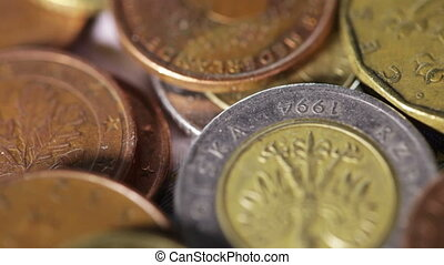 Coins EU on rotating surface on burlap background