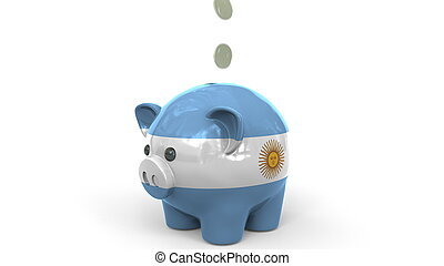 Coins fall into piggy bank painted with flag of Argentina. National banking system or savings related conceptual 3D rendering