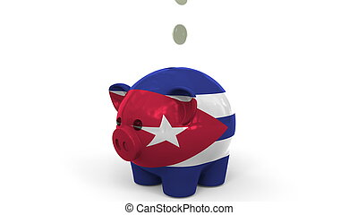 Coins fall into piggy bank painted with flag of Cuba. National banking system or savings related conceptual 3D rendering
