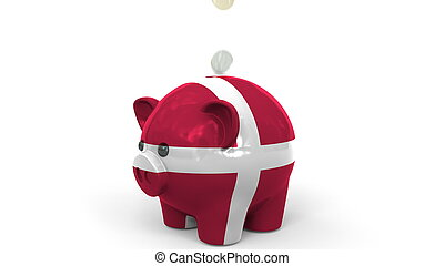 Coins fall into piggy bank painted with flag of Denmark. National banking system or savings related conceptual 3D rendering
