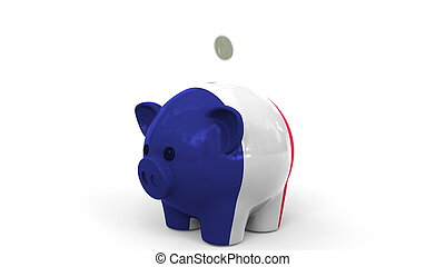 Coins fall into piggy bank painted with flag of France. National banking system or savings related conceptual 3D rendering