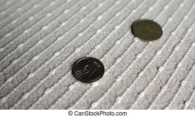 Coins fall onto a texture surface - Coins fall and bounce...