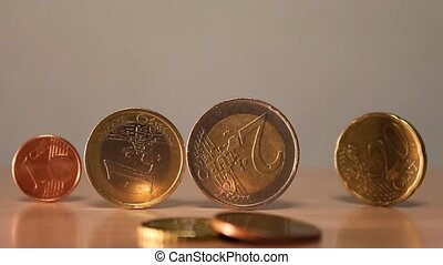 economic crisis - coins falling down as a concept of...