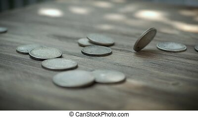 Coins Falling in Slow Motion and Hitting a Wooden Table and Each Other. Slowmo Silver American Dollars Falling Down