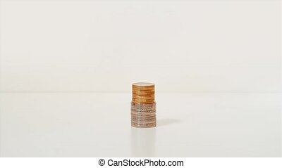 Coins grow high on a white background