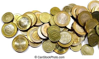 Coins heap - Camera pans right over coins.
