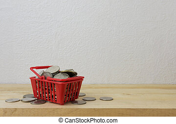 coins in a basket red for money concept
