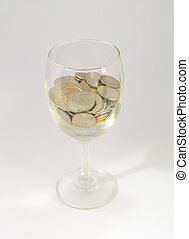 Coins in a glass dish. Shooting through glass