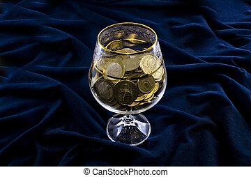 Coins in a glass.