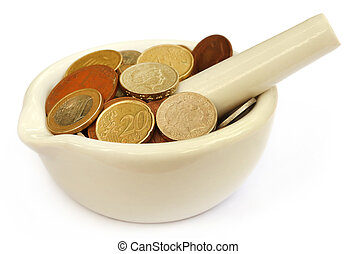 Coins in a mortar with pestle