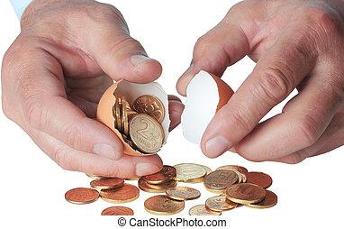 Coins in broken eggshell, in hand