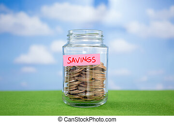 Coins in glass bottle with Savings label