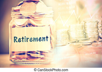 Coins in glass jar with retirement label for money saving financial concept