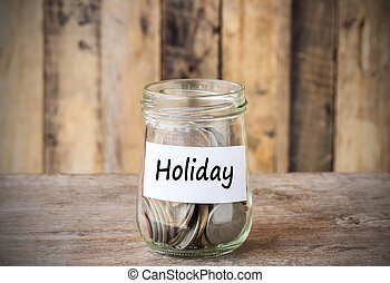 Coins in glass money jar with holiday label, financial concept.