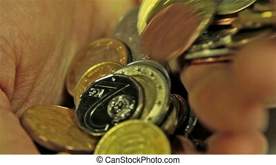 Coins in Hands. Close up shot