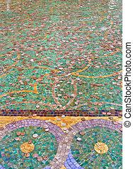 Coins in Mosaic Tile Fountain
