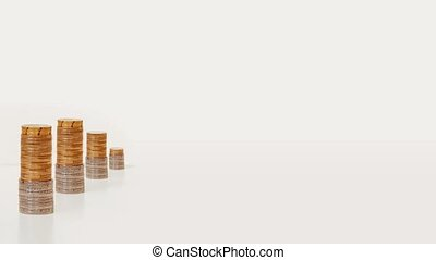 Coins in stop motion in the form of a rising graph