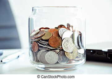 Coins in the glass jar - multi Asian currencies - saving concept