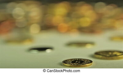 Coins on the table. Close up, follow focus shot
